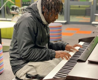 Ashley playing the piano